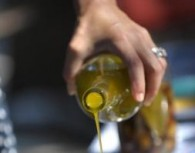 Woman Pouring Olive Oil